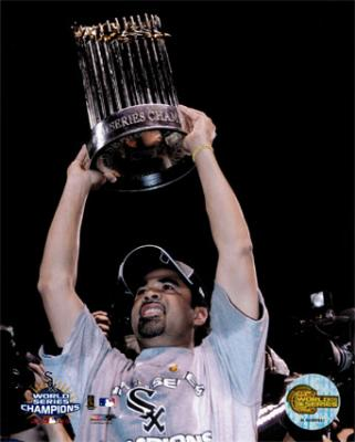20100105054646-aags212-ozzie-guillen-celebrating-with-2005-world-series-championship-trophy-posters.jpg